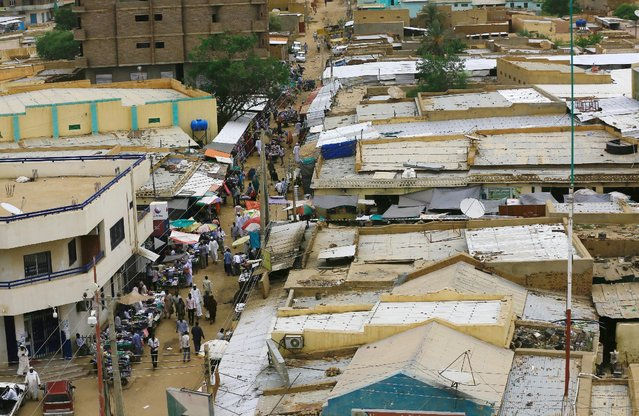 An overhead view of a market is seen in Al Fashir, capital of North Darfur September 5, 2016. (Photo by Mohamed Nureldin Abdallah/Reuters)