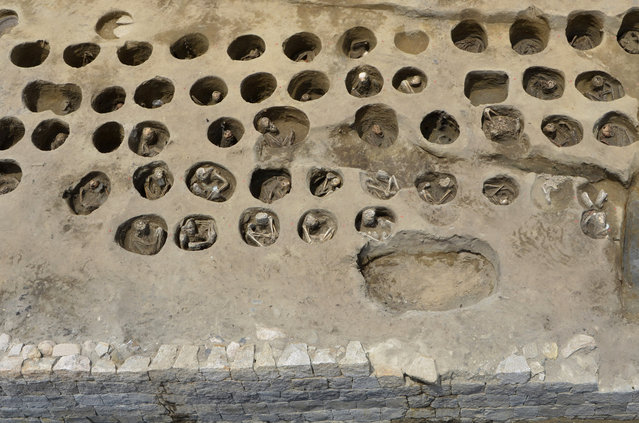 """This undated photo provided Wednesday, August 26, 2020, by Osaka City Cultural Properties Association shows human bones buried in holes at the south section of the """"Umeda Grave"""" burial site, in Osaka, western Japan. The photo was taken during the cemetery research between Sept. 2019 and Aug. 2020. Archaeologists have dug up remains of more than 1,500 people, many of them showing signs of death from epidemic, at a site of a 19th century mass grave during excavation ahead of a city development project near a main train station in Osaka, western Japan. (Photo by Osaka City Cultural Properties Association via AP Photo)"""