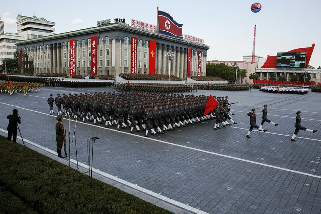 Soldiers hold their weapons as they march past a stand with North Korean leader Kim Jong Un during the parade celebrating the 70th anniversary of the founding of the ruling Workers' Party of Korea, in Pyongyang October 10, 2015. (Photo by James Pearson/Reuters)