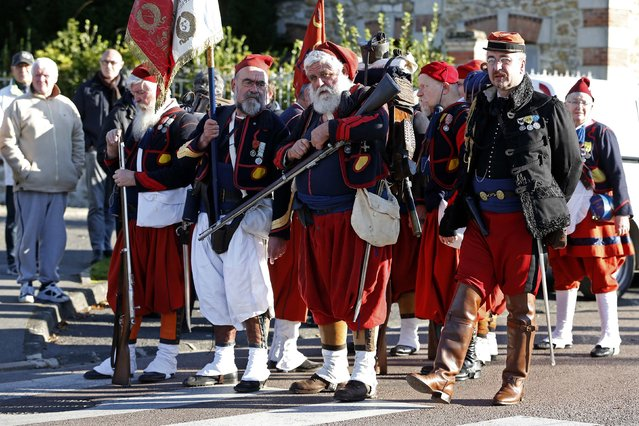 """History enthusiasts of French association """"Arquebusiers de l'Est"""", dressed as soldiers of 3rd regiment of Zouave, attend an Armistice Day ceremony to commemorate the end of World War One at Chateau Thierry, eastern France, November 11, 2014. (Photo by Charles Platiau/Reuters)"""