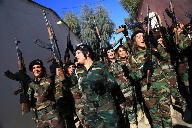 Female Peshmerga officers celebrate after their graduation ceremony, at Zakho military academy in Zakho town, Dohuk, Kurdistan Region in Iraq, 30 January 2018. (Photo by Gailan Haji/EPA/EFE)