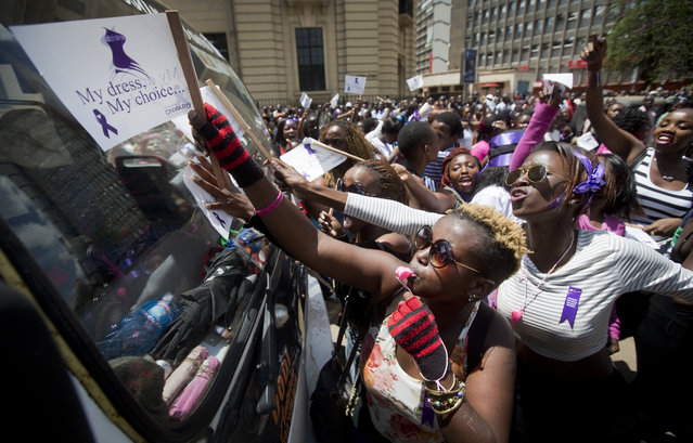 Kenyan women protest for the right to wear whichever clothes they want, at a demonstration in downtown Nairobi, Kenya Monday, November 17, 2014. (Photo by Ben Curtis/AP Photo)