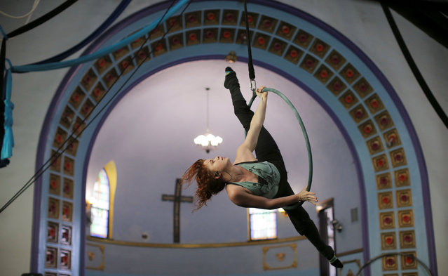 Julie Marshall trains on the aerial hoop at the Aloft Loft circus training and teaching school which was converted from a church, in Chicago, Illinois, U.S., September 22, 2016. (Photo by Jim Young/Reuters)