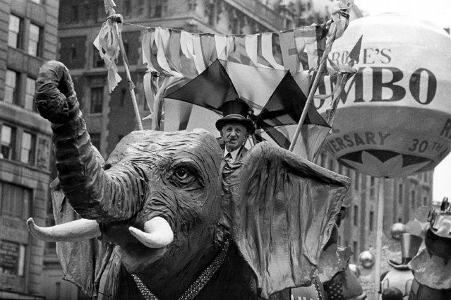 Comedian Jimmy Durante rides on a Jumbo the elephant float during the annual Macy's Thanksgiving Day Parade in New York City on November 22, 1962. (Photo by AP Photo)