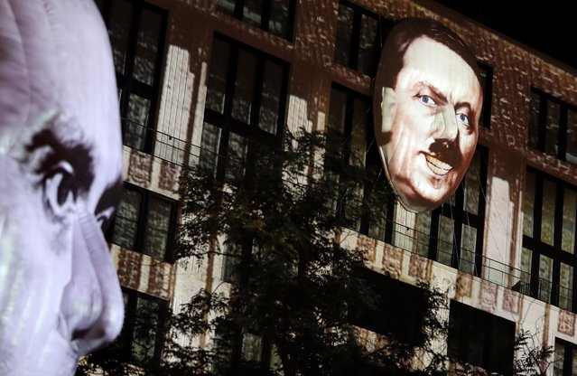 "The faces of Adolf Hitler, right, and Joseph Goebbels, left, are projected onto 3D canvases as part of an art installation during a rehearsal for the ""Berlin Leuchtet"" (Berlin shines) festival in Berlin, Germany, Thursday, September 29, 2016. ""Berlin Leuchtet"" takes place from Sept. 30 until Oct. 16, 2016 in the German capital. (Photo by Michael Sohn/AP Photo)"