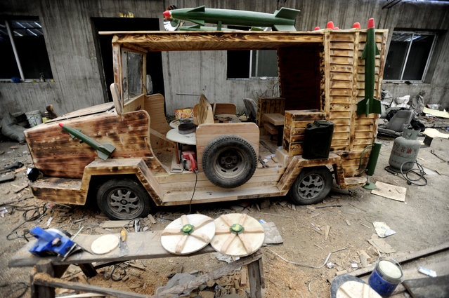A general view of a electric wooden armored vehicle made by Liu Fulong, a 48-year-old carpenter, on December 3, 2014 in Shenyang, Liaoning province of China. Chinese carpenter Liu Fulong has built a home-made electric wooden armored vehicle which has a missile and radar. The armored vehicle is 2.5 meters long, 1.3 meters wide and over 350 kilograms in weight with a top speed of up to 50 km/h. The vehicle cost him about 20,000 RMB (about 3252 USD) to build. (Photo by ChinaFotoPress/ChinaFotoPress via Getty Images)