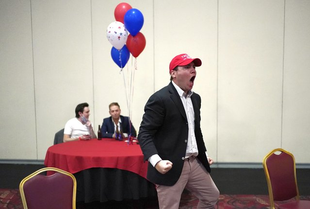 Donald Trump supporter John McGuinness celebrates while watching election returns in favor for Trump at a Republican election night watch party, Tuesday, November 3, 2020, in Las Vegas. (Photo by John Locher/AP Photo)
