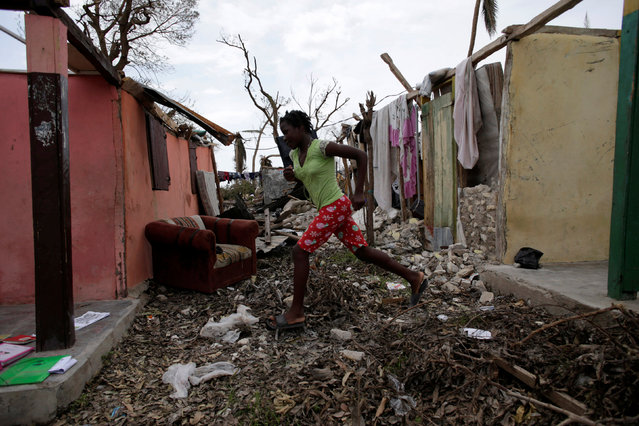 A girl runs next to houses affected by Hurricane Matthew in Port-a-Piment, Haiti, October 9, 2016. (Photo by Andres Martinez Casares/Reuters)