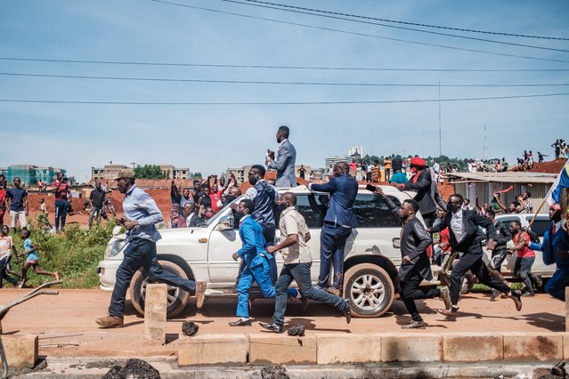 Musician turned politician Robert Kyagulanyi (C top), also known as Bobi Wine, greets supporters as he makes his way to be officially nominated as presidential candidate, in Kampala, Uganda on November 03, 2020. Bobi Wine was officially nominated today as presidential candidate for the upcoming 2021 elections, where he will challenging President Yoweri Museveni, who has been in power for 35 years. (Photo by Sumy Sadurni/AFP Photo)