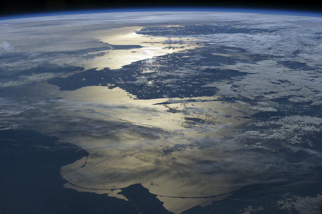 Baltic sea seen from the ISS. Image taken on 15th June 2014. The Baltic Sea (C) is located in Europe. The southern coast of Norway appears at the far top middle, below it is Sweden. Denmark is far left, Poland lower left corner, Russia bottom middle and Lithuania lower right corner on June 15, 2014 at Baltic Sea. (Photo by NASA/SPL/Barcroft Media)