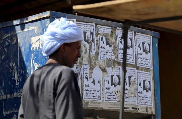 A man walks past electoral fliers at the touristic Nubian Gharb Suheil village, near Aswan south of Egypt, October 1, 2015. (Photo by Mohamed Abd El Ghany/Reuters)