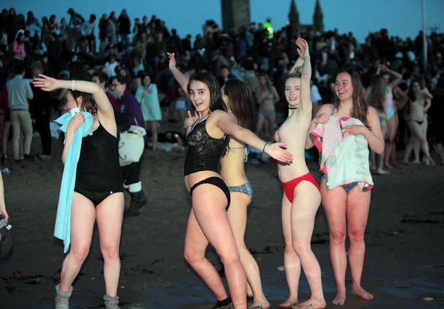 Students from the University of St Andrews jump into The North Sea, as a good luck tradition before exams start on the East Sands in St Andrews, Fife, Scotland on May 1, 2018. (Photo by Derek Allan/Alamy Live News)