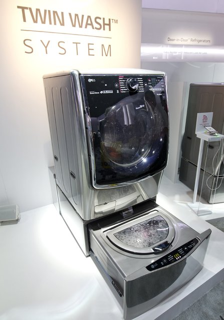 An LG Electronics Twin Wash System washing machine is displayed  during the 2015 International Consumer Electronics Show (CES) in Las Vegas, Nevada January 6, 2015. The washer has a second, smaller washer built into the bottom of the machine for doing two different loads at once. (Photo by Steve Marcus/Reuters)