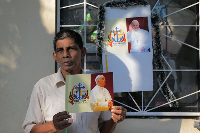 In this Wednesday, January 7, 2015 photo, a Sri Lankan Catholic devotee Antony Fernando poses for a photograph at a church in Wattala, in the outskirts of Colombo, Sri Lanka. Fernando believes he was born to be a member of a minority religious group as per God's will and that it is special gift. (Photo by Eranga Jayawardena/AP Photo)