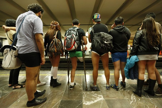 """Passengers without pants wait for the subway train during """"The No Pants Subway Ride"""" in Mexico City January 11, 2015. The event, the fifth organized in Mexico, is an annual flash mob and occurs in different cities around the world, according to its organisers. (Photo by Edgard Garrido/Reuters)"""