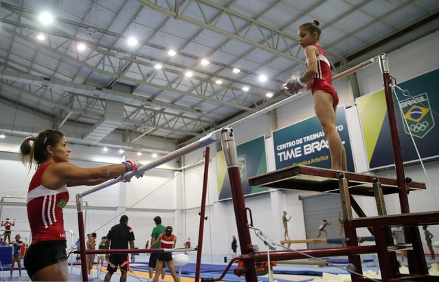 Brazilian gymnast Flavia Saraiva (R) listens to her teammate Jade Barbosa during a training session at the new Brazilian Artistic Gymnastics Center in Rio de Janeiro January 16, 2015. (Photo by Sergio Moraes/Reuters)