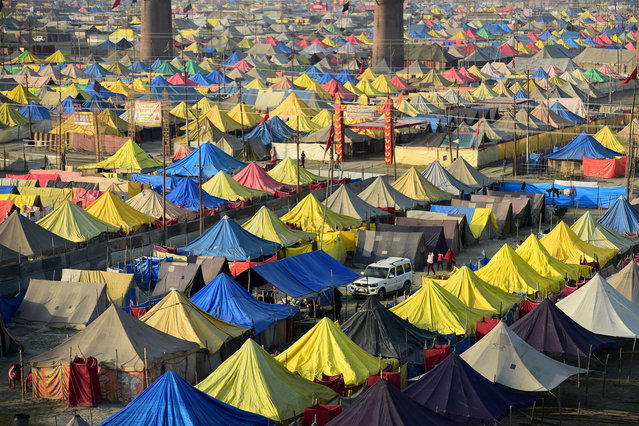 Temporary tents are seen along the Sangam, the confluence of the rivers Ganges, Yamuna and mythical Saraswati during the annual Hindu religious fair of Magh Mela in Allahabad on February 2, 2021. (Photo by Sanjay Kanojia/AFP Photo)