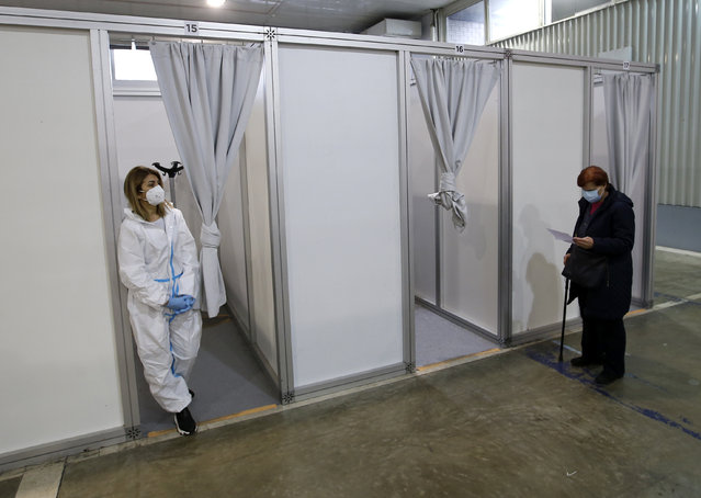 A medical worker wearing protective gear, waits for patients to receive the COVID-19 vaccine at a vaccination center in Belgrade, Serbia, Wednesday, February 17, 2021. Serbia, a country of 7 million, has so far vaccinated some 1 million people, mainly with the Chinese Sinopharm vaccine and Russian Sputnik V, and to a lesser extent with the Pfizer jab. (Photo by Darko Vojinovic/AP Photo)