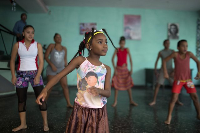 Sakia Corona, 8, (C) takes part in a rehearsal of the Contemporary Haitian Dance in a communal center in downtown Havana January 30, 2015. (Photo by Alexandre Meneghini/Reuters)