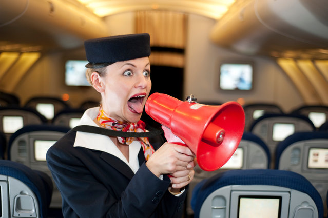 Stewardess with megaphone. (Photo by Emmanuel Aguirre/Getty Images)