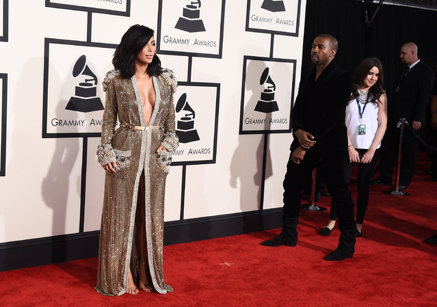 Kim Kardashian, left and Kanye West arrive at the 57th annual Grammy Awards at the Staples Center on Sunday, February 8, 2015, in Los Angeles. (Photo by Jordan Strauss/Invision/AP Photo)
