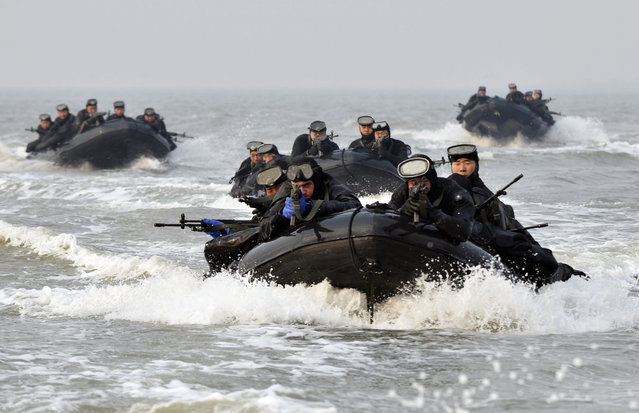 South Korean and United States marines ride on inflatable boats during a joint landing exercise to prepare for a possible North Korea's surprise attack in waters off Ganghwa Island, located inside of the civilian passage restriction line that separates the two Koreas since the Korean War, South Korea, Tuesday, February 10, 2015. (Photo by AP Photo/Yonhap)