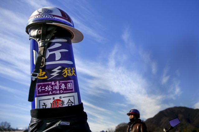 A helmet rests on the raised passenger saddle of a Bousouzoku style motorbike at the Dangouzaka rest stop in Yamanashi, west of Tokyo, Japan, January 3, 2016. (Photo by Thomas Peter/Reuters)