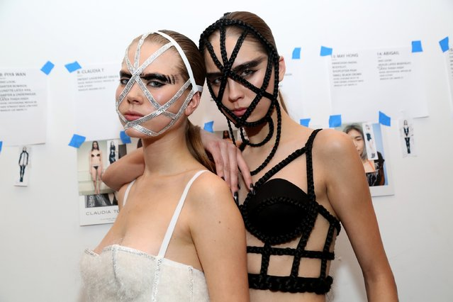 Models pose for a picture backstage at the Chromat AW15: Mindware fashion show during Mercedes-Benz Fashion Week Fall 2015 at Milk Studios on February 13, 2015 in New York City. (Photo by Monica Schipper/Getty Images for Chromat)