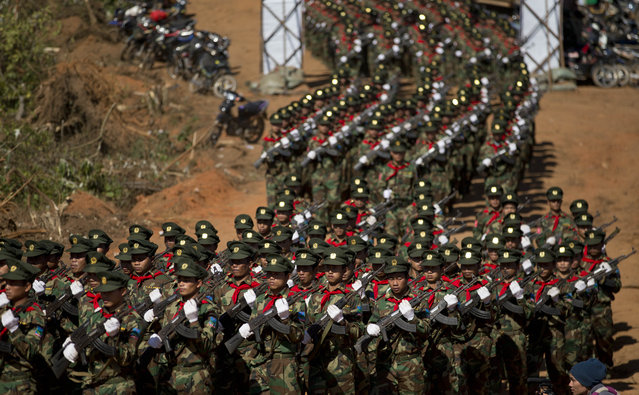 In this January 12, 2015 photo, Ta'ang National Liberation army troops march in Mar Wong Village, northern Shan state during a celebration marking the 52nd anniversary of their insurrection against successive Myanmar governments. (Photo by Gemunu Amarasinghe/AP Photo)