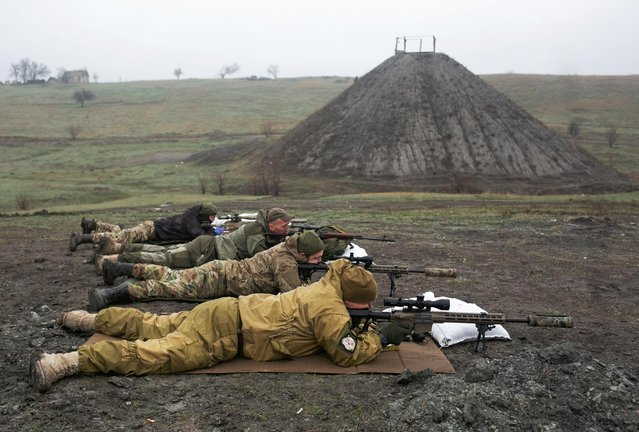 Snipers of the Ukrainian armed forces aim their rifles during training at a firing range near the town of Marinka in Donetsk region, Ukraine on April 13, 2021. (Photo by Anastasia Vlasova/Reuters)
