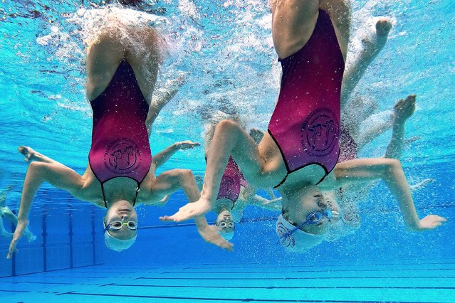 Athletes of the Tatarstan regional swimming team practice before Leg 3 of the 2021 FINA Artistic Swimming World Series at the Palace of Water Sports in Kazan, Russia on April 16, 2021. (Photo by Yegor Aleyev/TASS)