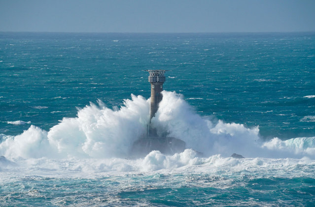 Waves crash over the Longships Lighthouse on October 28, 2020 just off the coast in Land's End, England. Parts of the west coast of England are being battered by huge waves which are the outer effects of storm Epsilon, currently mid-Atlantic. (Photo by Hugh R. Hastings/Getty Images)