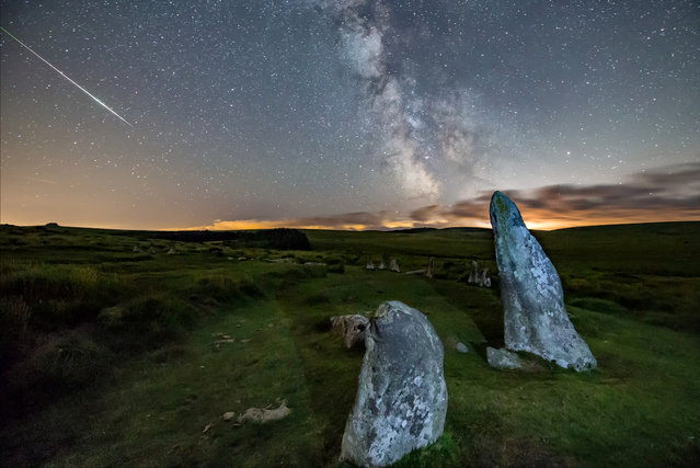 The Perseid Meteor Shower seen over The Scorhill Stone Circle in Dartmoor, Devon on August 2, 2016. (Photo by John Baker/SWNS.com)