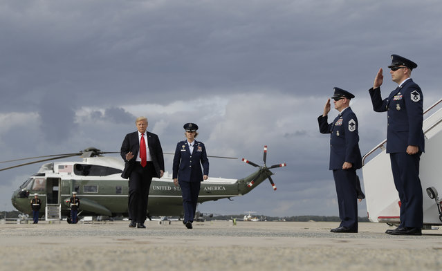 President Donald Trump boards Air Force One for a campaign rally in Erie, Pa., Wednesday, October 10, 2018, in Andrews Air Force Base, Md. (Photo by Evan Vucci/AP Photo)