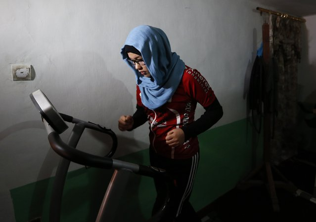 Masooma Alizada, a member of Afghanistan's Women's National Cycling Team, exercises in Kabul February 20, 2015. (Photo by Mohammad Ismail/Reuters)
