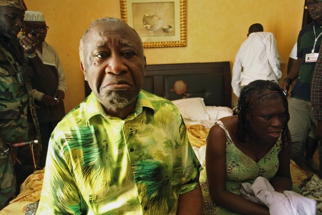 Ivory Coast's Laurent Gbagbo (L) and his wife Simone sit in a room at Hotel Golf in Abidjan, after they were arrested, April 11, 2011. Former Ivory Coast President Laurent Gbagbo goes on trial at the International Criminal Court on Thursday, the most senior politician to do so since the global war crimes tribunal was set up 13 years ago. (Photo by Reuters/Stringer)