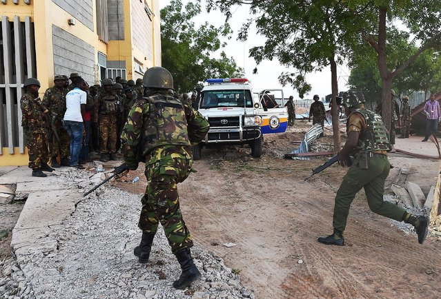 Kenyan Defence Forces run towards the Garissa University campus after an attack by Somalia's Al-Qaeda-linked Shebab gunmen in Garissa on April 2, 2015. At least 70 students were massacred when Somalia's Shebab Islamist group attacked a Kenyan university today, the interior minister said, the deadliest attack in the country since US embassy bombings in 1998. (Photo by Carl De Souza/AFP Photo)