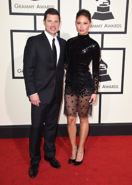 Nick Lachey, left, and Vanessa Lachey  arrive at the 58th annual Grammy Awards at the Staples Center on Monday, February 15, 2016, in Los Angeles. (Photo by Jordan Strauss/Invision/AP Photo)