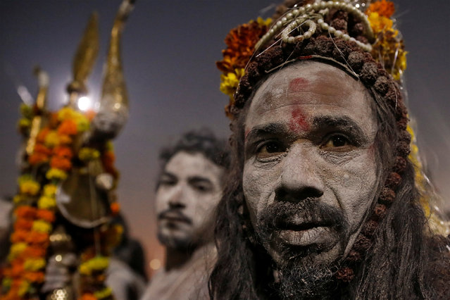 "Naga Sadhus or Hindu Holy men leave after taking a dip during the first ""Shahi Snan"" (grand bath) at ""Kumbh Mela"" or the Pitcher Festival, in Prayagraj, previously known as Allahabad, India, January 15, 2019. (Photo by Danish Siddiqui/Reuters)"