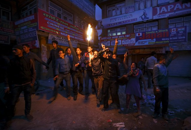 Protesters take part during the torch rally in Kathmandu April 6, 2015. (Photo by Navesh Chitrakar/Reuters)