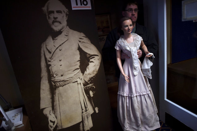 John Buchhesiter, 46, carries out a wax figure of First Lady Abigail Fillmore to his car after purchasing it from an auction of the Hall of Presidents Museum, which closed in November, in Gettysburg, Pennsylvania, U.S. January 14, 2017. (Photo by Mark Makela/Reuters)