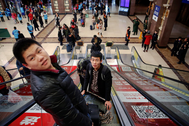 Passengers arrive to the Beijing Railway Station in central Beijing, China January 13, 2017 as the annual Spring Festival travel rush begins ahead of the Chinese Lunar New Year. (Photo by Damir Sagolj/Reuters)