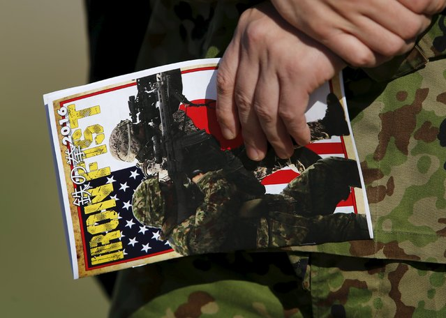 An officer from Japan's Ground Self Defense Force holds a pamphlet as he attends training with U.S. Marines during the bilateral annual Iron Fist military training exercise in Camp Pendleton, California February 26, 2016. (Photo by Mike Blake/Reuters)
