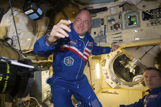 NASA astronaut Scott Kelly is shown with flight engineer Sergey Volkov (R) from the International Space Station in this NASA image released on February 29, 2016. NASA astronaut Scott Kelly, who returns on March 2, 2016 after nearly a year aboard the International Space Station, said on Thursday the secret to enduring the longest U.S. spaceflight is marking individual milestones, not ticking days off the calendar. (Photo by Reuters/NASA)