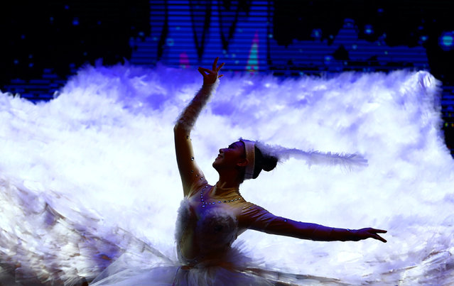 Performer take part in a celebration for the upcoming Chinese New Year at Lisinski hall in Zagreb, Croatia, January 23, 2017. (Photo by Antonio Bronic/Reuters)