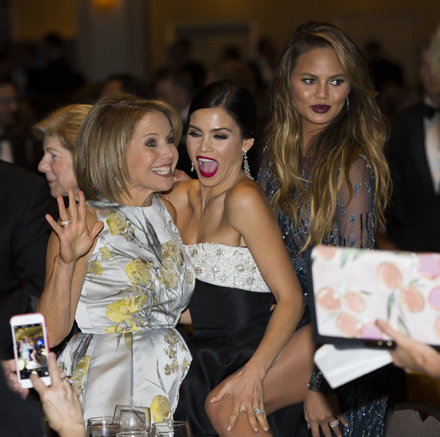 News personality Katie Couric, left, Jenna Dewan-Tatum, center, and model Chrissy Teigen mingle during the White House Correspondents' Association dinner at the Washington Hilton on Saturday, April 25, 2015, in Washington. (Photo by Evan Vucci/AP Photo)