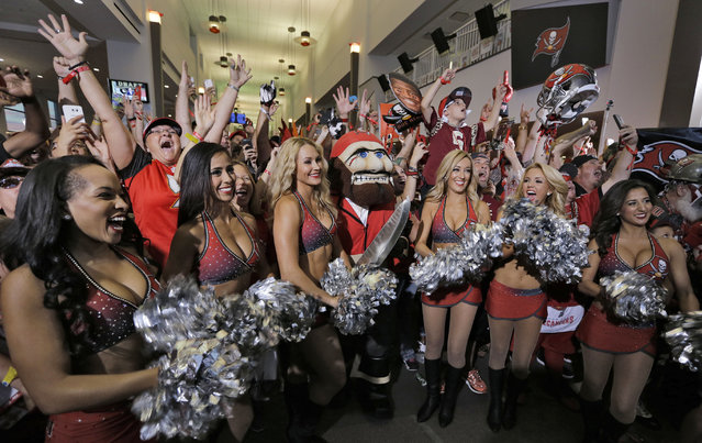 The Tampa Bay Buccaneers cheerleaders celebrate along with fans after the team drafted former Florida State quarterback Jameis Winston during an NFL draft party Thursday, April 30, 2015, in Tampa, Fla. Winston was the first overall pick in the draft. (Photo by Chris O'Meara/AP Photo)