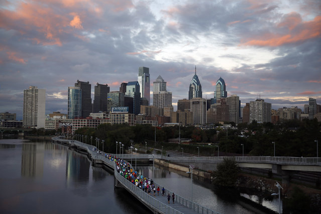 In this October 1, 2014 file photo, runners jog along the Schuylkill Banks Boardwalk in Philadelphia. (Photo by Matt Slocum/AP Photo)