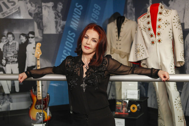 """Priscilla Presley stands in the """"60 years of Elvis"""" exhibit inside an annex at Graceland on Friday, February 21, 2014, in Memphis, Tenn. The exhibit, which opens Monday, February 24, 2014 features jump suits worn by Presley, an organ played in his California home, a copy of the original """"That's All Right"""" record and other miscellaneous Elvis items. (Photo by Lance Murphey/AP Photo)"""
