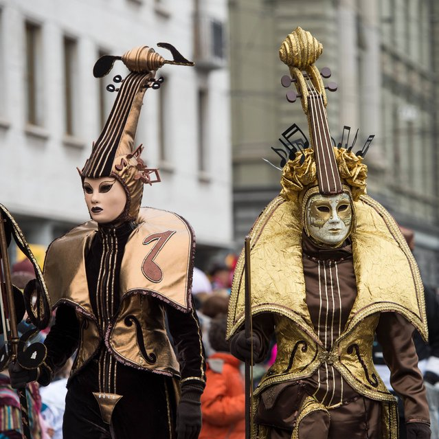 Costumed revellers  walk in the streets of Lucerne during the annual carnival parade   on Rose Monday  March 3, 2014. (Photo by Sigi Tischler/AP Photo/Keystone)